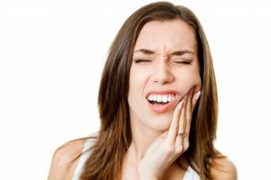 أعراض فشل زراعة الأسنان
